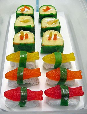 Such a cute idea!! The sushi roll is made of twinkies. I don't know what it's wrapped in, probably a fruit rollup. Then swedish fish for the nigiri!! :D party ideas - Google Search