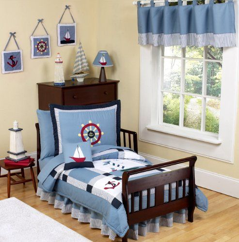 $89.99-$83.99 Baby Come Sail Away 5 pc. Toddler Bedding Ensemble has all that your little sailor will need.   This charming and classic set is decorated in a nautical theme with embroidered helm wheels, anchors, boats, and lighthouses set upon soft chambray fabric. A Chambray blue background with white, red, navy, yellow gingham, blue and white striped accents adorn this clever nautical themed s ...