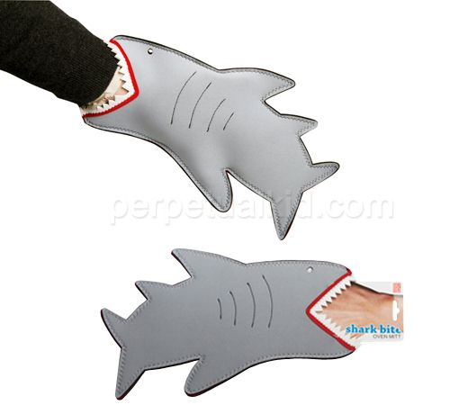 Shark Bite Oven Mitt... I want to order this for Shark Week next month!  I love that it is ambidextrous also, so it can look just as awesome on a lefty trying not to burn herself. :/