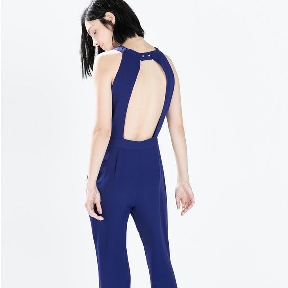 Zara Basic royal blue backless jumpsuit Zara Basic royal blue backless jumpsuit. Features slimming pleating details at neckline and at waist. It also has pockets! New without tags, size medium best fits US 8. Zara Pants Jumpsuits & Rompers