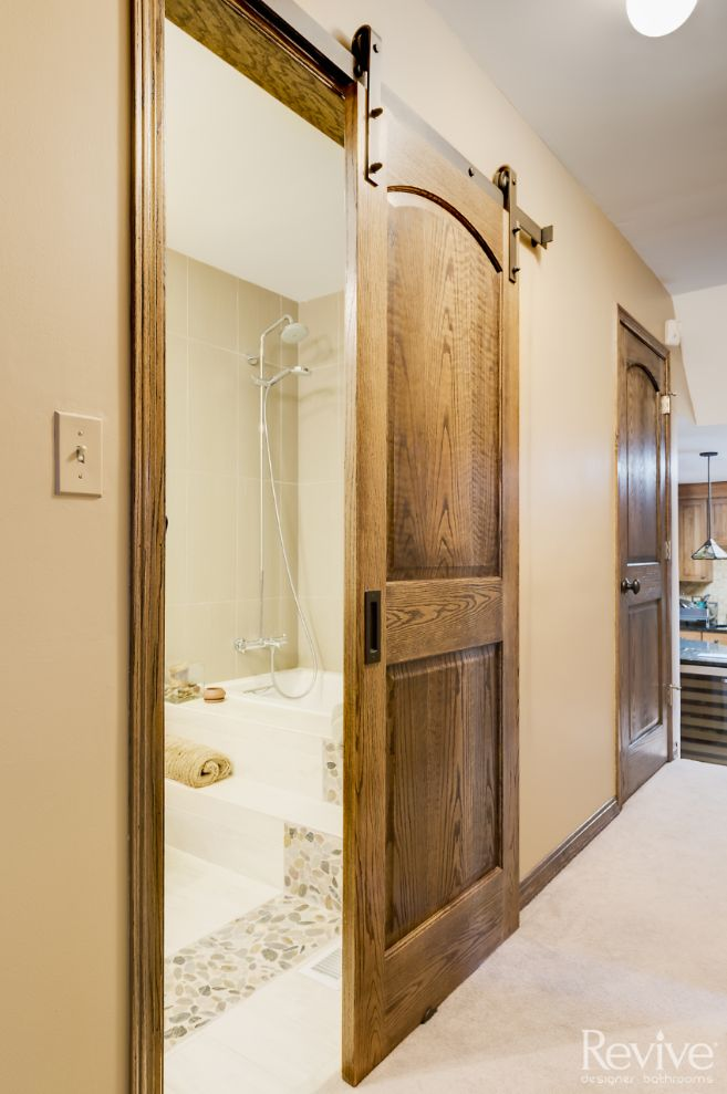 These sliding wooden barn doors make this Downers Grove bathroom feel like it's fresh out of the southwest.