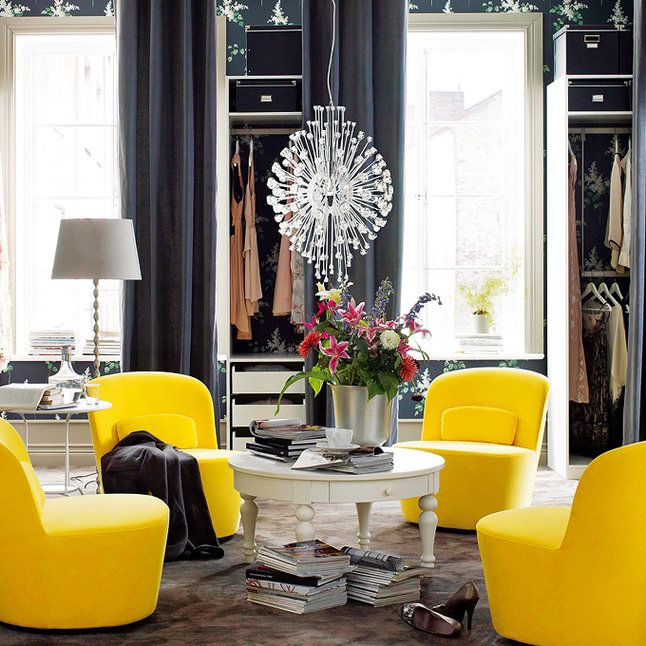 yellow modern chairs, a crystal chandelier, and navy wallpaper // luxury closets
