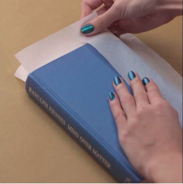Step 1: Wrap The Book With Rice Paper   How To Make A DIY Book Clutch   DIY Projects.com