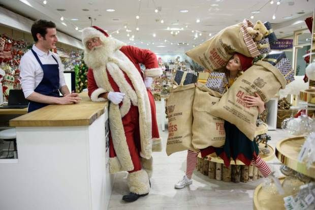 TOPSHOTS Father Christmas and an elf pose for photographs during a promotional event to launch the Selfridges Christmas Shop in their flagship store in central London on August 3, 2015. With 142 shopping days until Christmas, Selfridges is the first store to open it's festive department this year. AFP PHOTO/Leon NealLEON NEAL,LEON NEAL/AFP/Getty Images