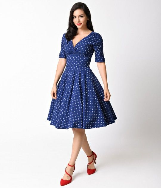 Become dedicated to Delores, darling. A beautiful navy blue dress, lavish in 1950s vintage appeal with adorable white anchor print throughout, fresh from Unique Vintage, Delores is exceptional! Featuring a gathered surplice v-neckline, trim and tailored h