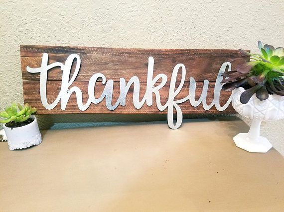 Check out this item in my Etsy shop https://www.etsy.com/listing/523479307/galvanized-metal-windmill-or-gather This thankful sign is just so pretty. The mix of old wood and pretty cursive metal letters sets it apart from other signs.