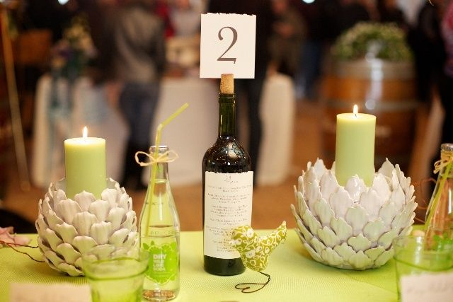 7 wine bottle centerpieces you can diy for your wedding for Homemade wine bottle centerpieces