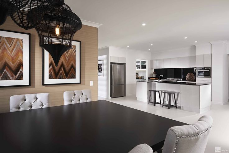 Dining room and kitchen in the Lakeview by Stylemaster Homes. On display at Pelican Waters.