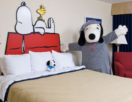 Wait, Snoopy can tuck you in to bed? We don't know if we should be excited or absolutely terrified.