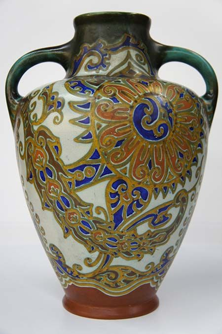 Antique Vase Art Nouveau Style 20th Century Circa 1915, Gouda, Holland, appraised in 2007 for $1,250. This stunning art nouveau style antique glossy vase displays vibrant colors of blue, green and gold depicting elegant geometric shapes. A truly unique vase with two handles mimicking amphora style pottery.