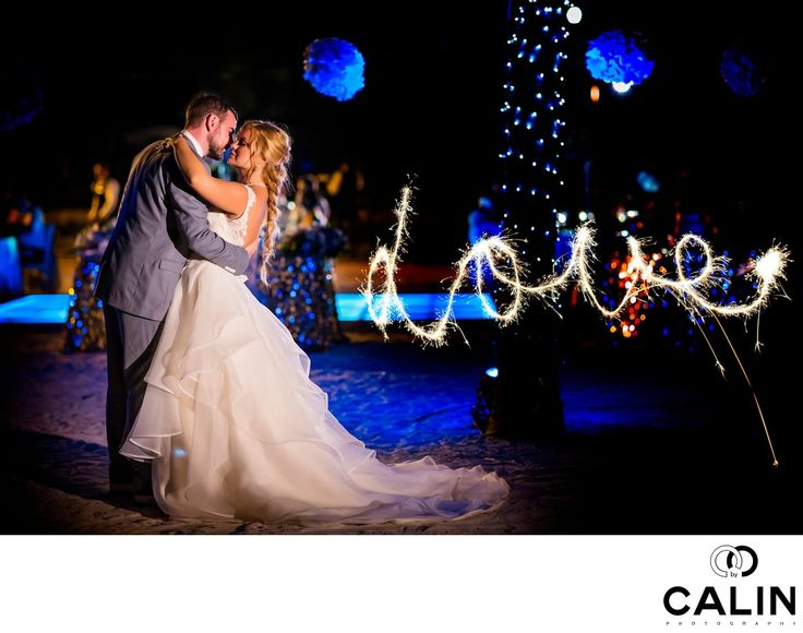 "Photography by Calin - Barcelo Maya Palace Deluxe Wedding - BRIDE, GROOM AND LOVE SPARKLERS:   This image of the bride and groom accompanied by the word ""Love"" written with sparklers is one of my most requested wedding photos. It is also one of my most recognisable images. As a wedding photographer documenting weddings in Toronto and abroad, I'm always on the hunt for new techniques that make my pictures stand out. This is one of them."