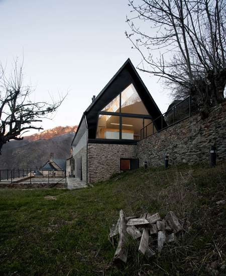 Architects Cadaval  Solà-Morales added this steeply-pitched roof to an old dry stone construction in the Spanish Pyrenees to form two homes. #Architecture