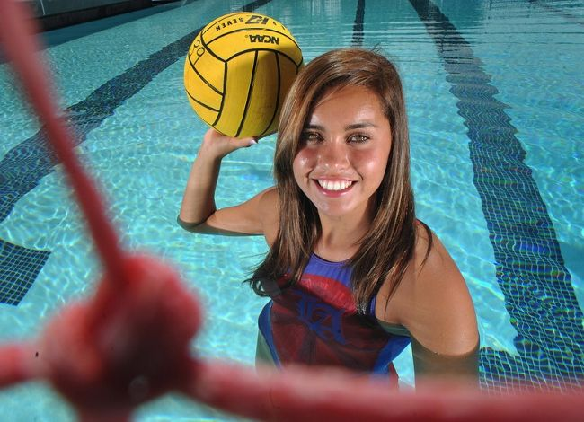 Girls Water Polo Senior Photo But treading... with elbow out of the water or floating/leaning on ball
