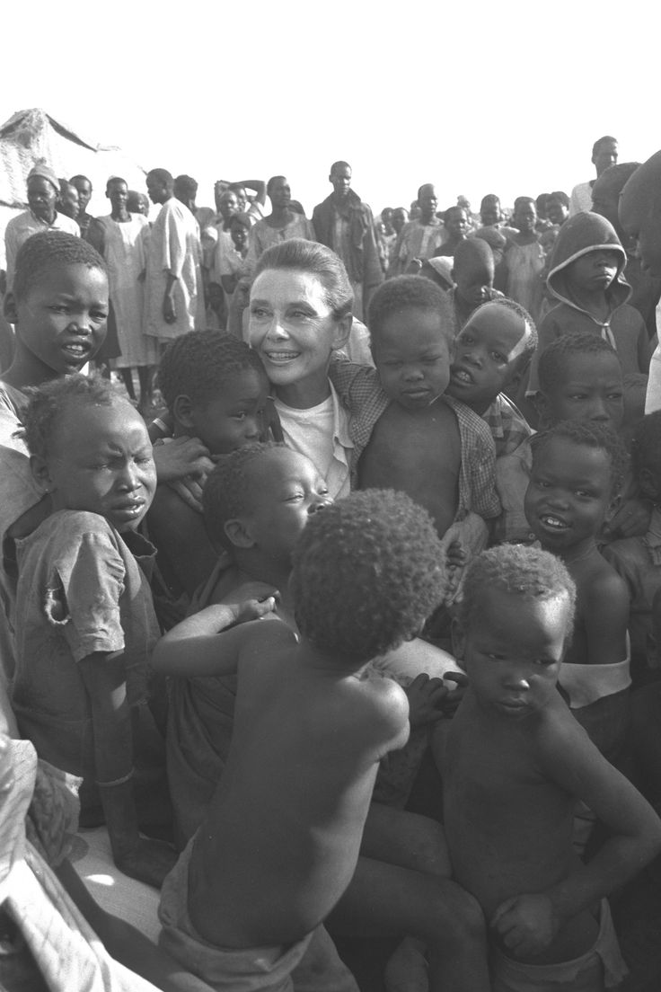 UNICEF Goodwill Ambassador Audrey Hepburn is surrounded by children (many suffering from eye diseases), during her visit to the IDP camp in Abyei province in West Kordofan State.  In 1989 in Sudan, UNICEF Goodwill Ambassador Audrey Hepburn travelled to central and southern Sudan to help draw attention to the plights of hundreds of thousands of internally displaced persons (IDPs) who continue to be affected by the civil conflict in this region.   Sudan © UNICEF/NYHQ1989-0205/Jeremy Hartley