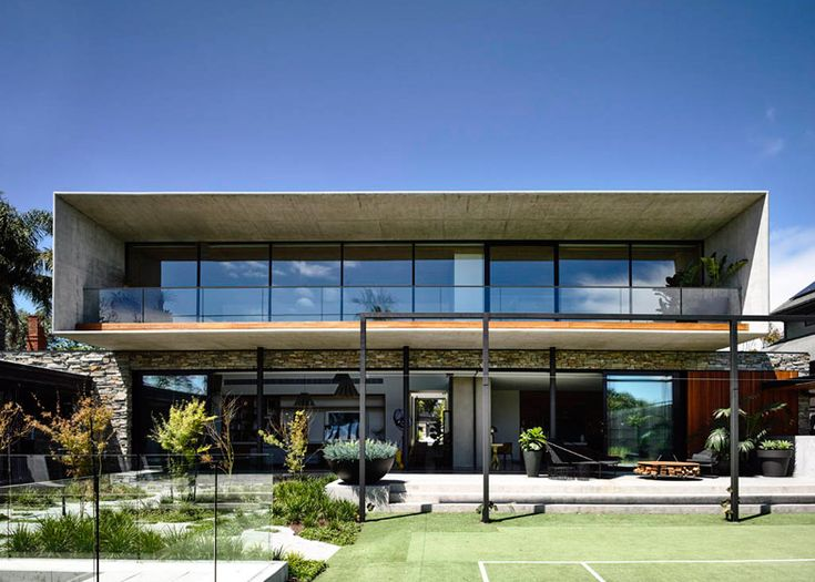 This concrete and stone house in a Melbourne suburb takes its design cues from Brazilian Modernist architecture and was designed for a commercial builder