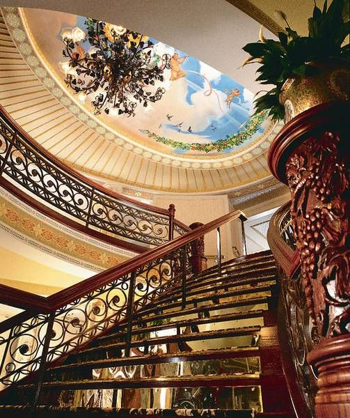 The grand staircase aboard the American Queen, a riverboat making 3 stops in Cape Girardeau this summer.  Photo thanks to the Great American Steamboat Company's website.