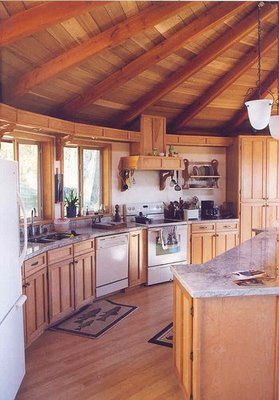 Modern kitchen in a wooden yurt.  No need to skimp on 21st century comforts to go eco!    Yeah, I'm into yurts.