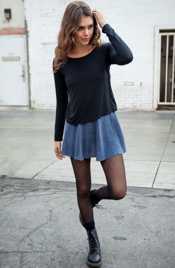 Black sweater, denim circle skirt, black tights, and black doc martains