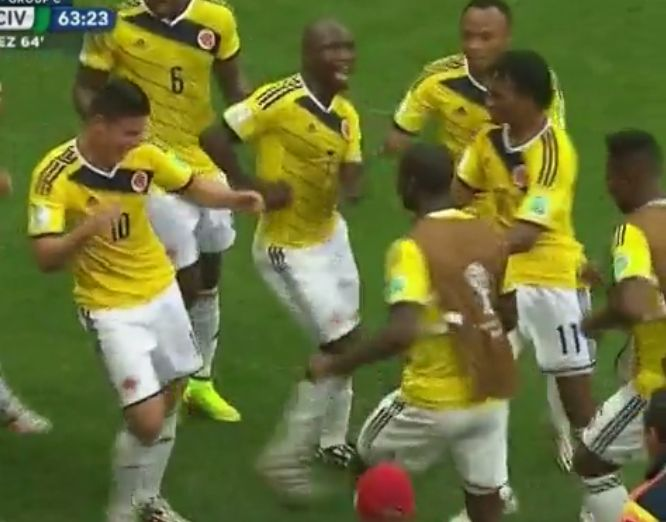 Colombia's James Rodriguez dances with team after scoring vs. Ivory Coast at the 2014 World Cup in Brazil. June 19, 2014