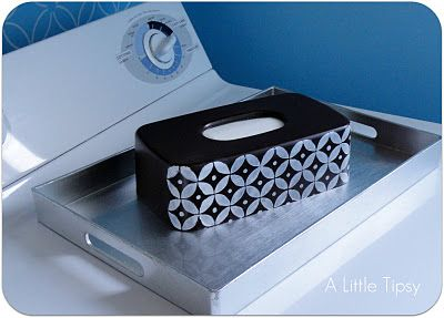 i love using tissue box to cover the dryer sheet box... genius!