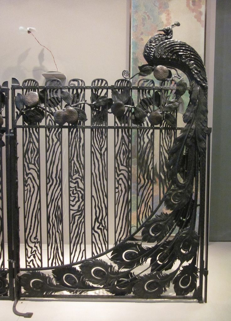 Section of peacock gate dedicated to birds by wrought iron master Jean Perrot on display at Musée des Arts Décoratifs