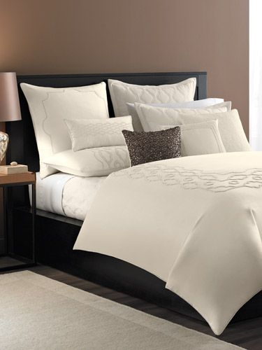 ivory bedding embellished with intricate embroidery makes for the most luxurious sleep your dreams will