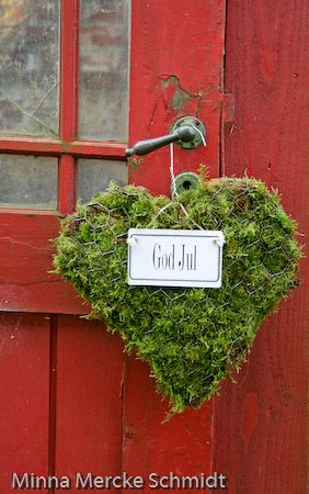 Oh I love this! Heart shaped moss wreath - a wire coat hanger is the wreath base.