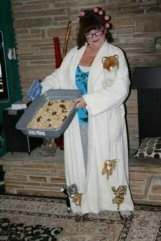 Crazy cat lady with kitty litter cake   eating the tootsie rolls really grosses folks out