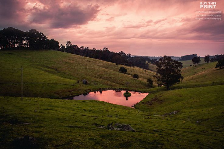 Sunsets in the water - A beautiful sunset in Historic Tilba gets reflected in a small farm dam in country Australia. This was taken on a solo motorcycle trip I took through country Australia from Sydney to Melbourne.
