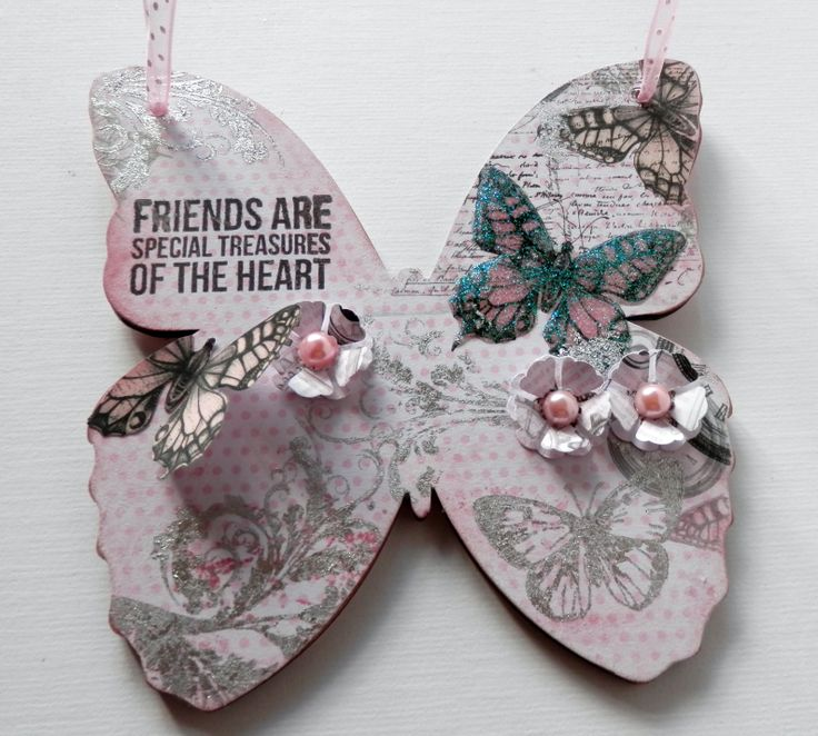"""Mdf butterfly decorated using the pink """"Time Flies"""""""