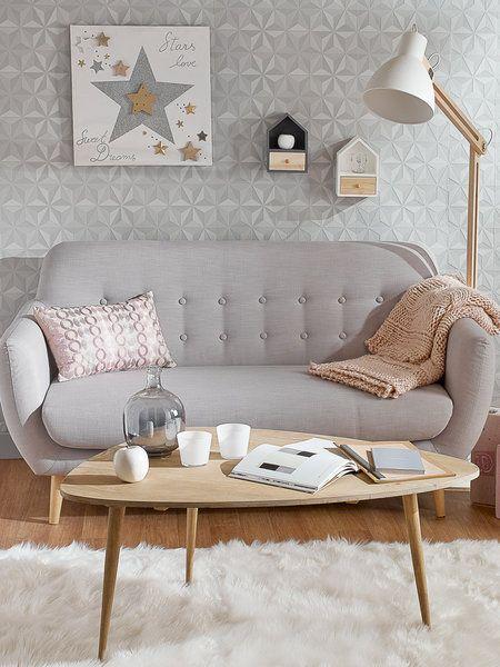 Salón nórdico en tonos paste con sofá, mesa y lámpara