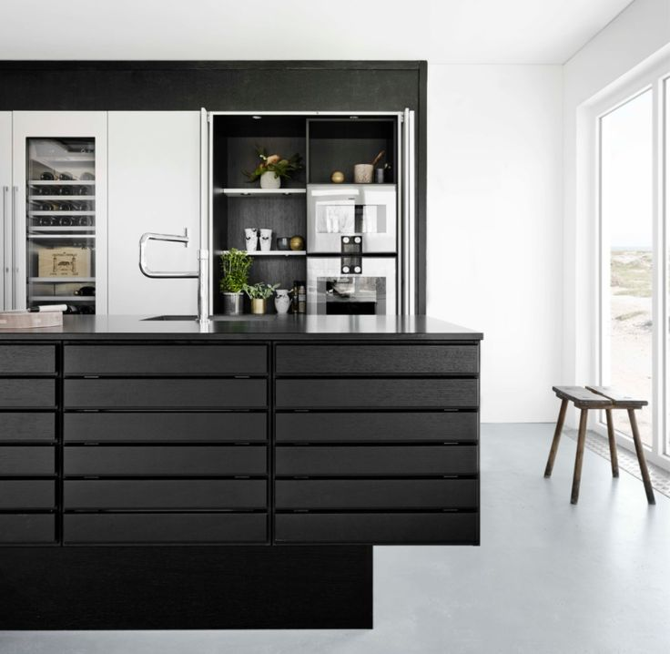 Form 1 // Black oak kitchen with Gaggenau elements by Multiform