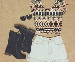 Black boots, white hotpants and muster top with black sunglasses