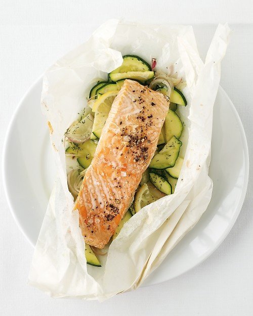 Salmon and Zucchini Baked in Parchment - Martha Stewart Recipes  It says: Put on a pot of rice when the salmon goes into the oven.  Both will be done at the same time, and you'll have a complete dinner, with only one pot to wash.