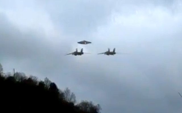 UFO SIGHTINGS DAILY: Two Military Jets Escorting UFO To Secret Base, Alien Tech In Military Hands? UFO Sighting News.