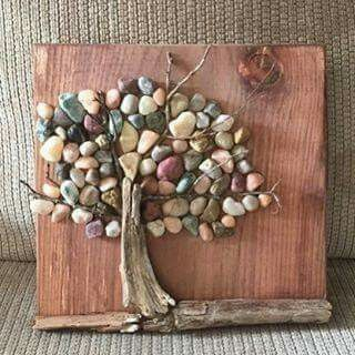 Tree made of driftwood and pebbles.