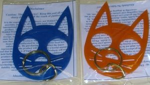Self defense weapon, Cat Keychain! The eye-holes are used for your knuckles and those pointy ears are VERY sharp! The plastic is hard and not easily broken. Defend yourself if attacked. They come in plenty of colors. I'm definitely getting one of these suckers.