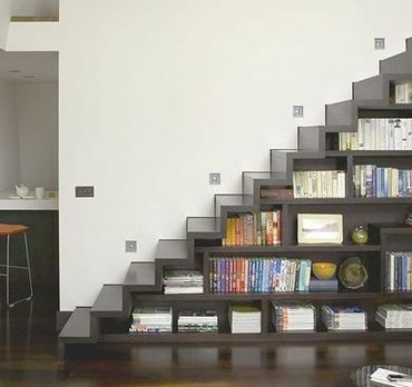 design by Levitate Architects via Home interiors - bookshelves in stairs