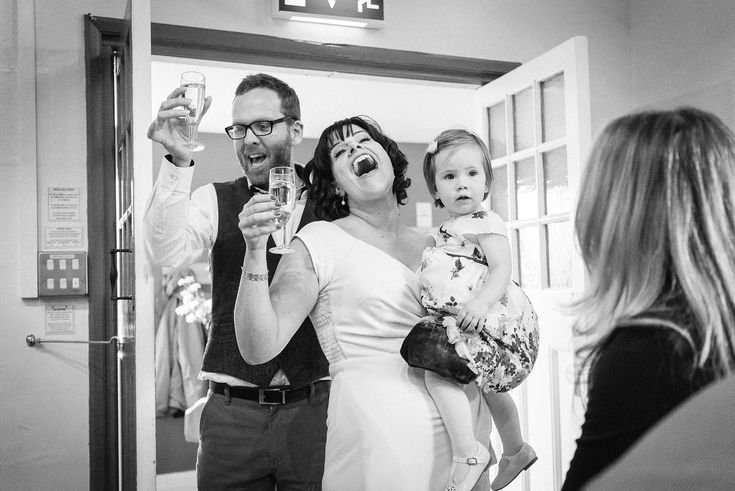 the entrance of the bride and groom and baby
