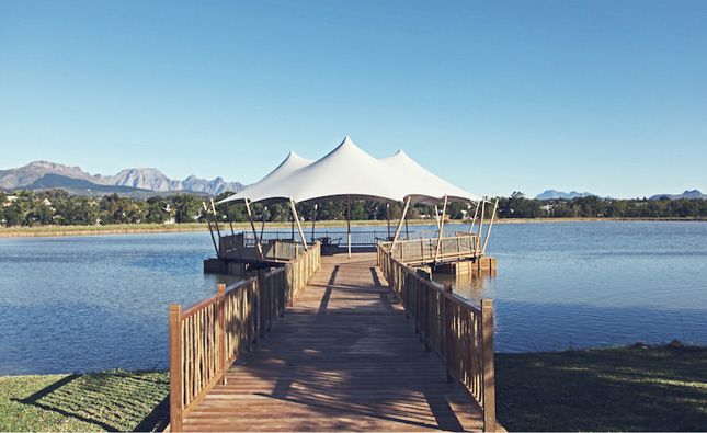 Custom stretch tent installation on a floating jetty.