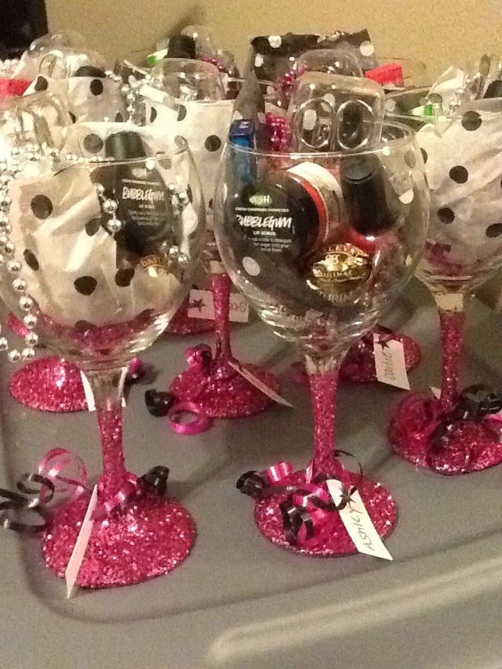 bachelorette favors with lushcosmetics and dollar store wine glasses modge podge glitter baileys bon bon and nail stuff