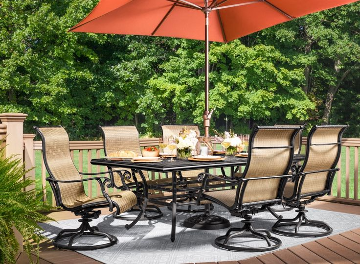 Dine outdoors in style with the Moreaux 7-piece outdoor dining set. Its cast aluminum table has the beautiful look of wrought iron yet is lighter in weight as well as corrosion-resistant for durability through the seasons. Swivel sling chairs add timeless transitional style to the set while providing a more casual look and feel. And with seating for 6, the set is ideal for both family dinners and entertaining. Add a table umbrella with base to your set for protection on sunny days.