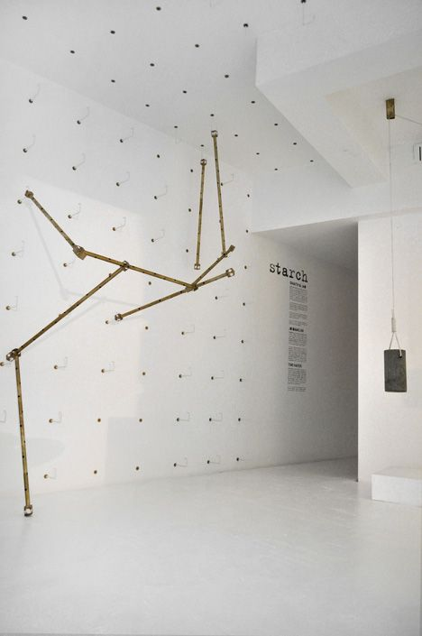 Ghaith & Jad build brass rod installation inside Beirut boutique.
