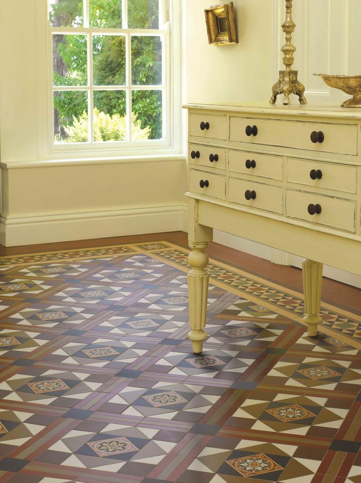 Victorian Floor Tiles - the Lindisfarne pattern with Stevenson border. Perfect for making a statement in an entrance area or hallway.