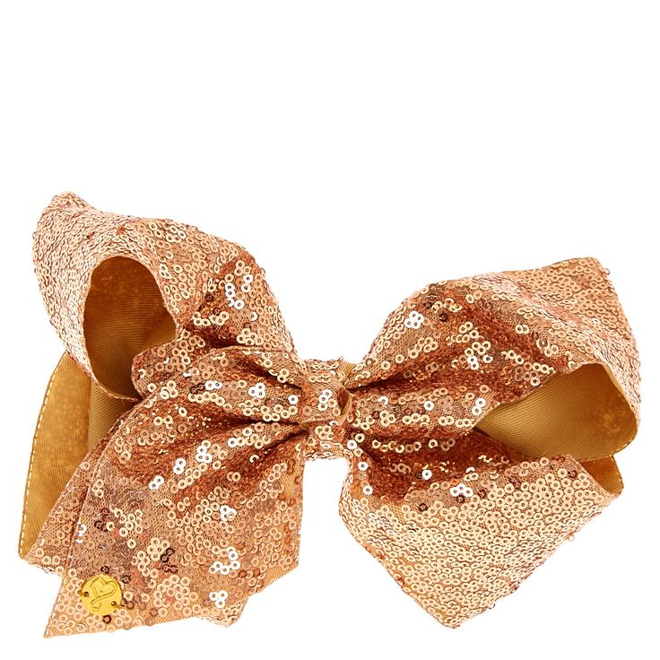 """<P>Get JoJo's classic look with this large sequin light gold hair bow from the JoJo Siwa collection. The bow has been attached to a metal salon clip making it really easy to wear. Also available in a white color and baby pink.</P><UL><LI>Jojo Siwa collection <LI>Large gold sequin bow <LI>W 7"""" x H 5"""" <LI>Metal salon clip</LI></..."""