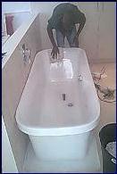 Our right hand man Fred - resurfacing a bath after a full bath respray.
