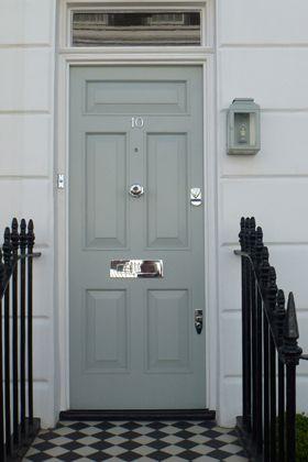 front door in farrow & ball's light blue + lantern + patterned porch