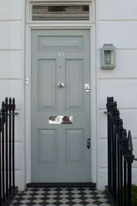 front door in farrow & ball's light blue + lantern + patterned porch stoop; love the choice of chrome accents for a change.