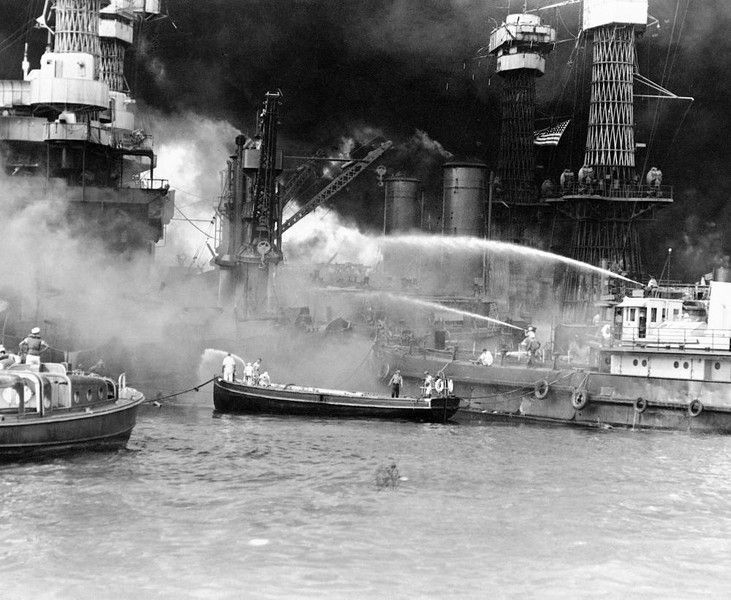 7 December 1941 - USS West Virginia in flames as fireboats work to contain the fire, Pearl Harbor, Oahu, US Territory of Hawaii - USS West Virginia (BB-48), a Colorado-class battleship. She was  hit by two bombs and seven torpedoes before sinking. 106 dead - She was returned to service July 1944.
