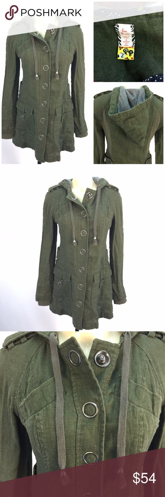 """Free People Coat Jacket Sz 2 Olive Green *  Military olive green snap front jacket/coat by Free People; size 2  * Whimsical oversized snap front; fitted shape w/back stretch panels; hood with drawstring & lining; front pockets; snap epaulets on shoulder; knit cuffs; unlined  * Please see below for measurements; all measurements taken with garment lying flat.  Please see all photos for complete condition assessment.  Shoulder to Shoulder: 15"""" Armpit to Armpit (Bust): 18"""" Waist: 16"""" Overall…"""
